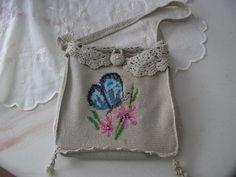 laget selv av min mors gamle strikkejakke¨. Brodert med maskesting og perler