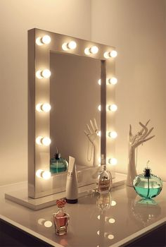 THE MIRROR INCLUDES * 10 x 3W golf ball LED bulbs (included) * Dimmer switch (right hand side) * Wall hung or attach to stand * Beautifully handmade construction * The Ultimate make up mirror * Protective High Gloss lacquer finish * 3 meter cable * CE & RoHS certified * 10 year warranty & manufacturers guarantee