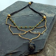 Make your own Empress of the Valley necklace! All supplies at http://www.ninadesigns.com/jewelry_design_ideas/gold_link_bib_necklace.html