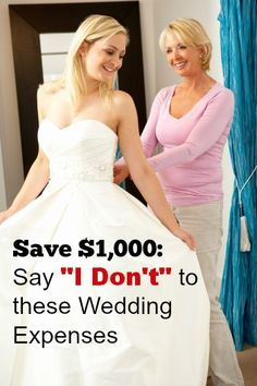 Bride at wedding dress fitting pin