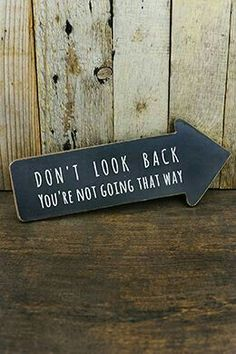"Direct your feet forward with this motivational Arrow Sign! The hanging arrow is made of wood and the front is made to look like a chalkboar. - ""Don't Look Back You're Not Going That Way"" Arrow Sign"