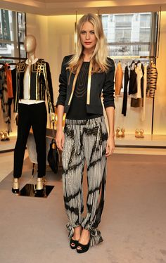 Poppy Delevingne dressed up this tie-dye (and side-slit infused) pair of pants with a cool cocktail jacket and sleek gold-accented accessori...