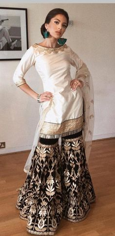 designer contrast white & black Salwar Suit with heavy embroidery on it. To customised this garment log on to www.in Classic Indian salwar CLICK VISIT link for more details Pakistani Wedding Outfits, Pakistani Dresses, Indian Dresses, Indian Outfits, Pakistani Gharara, Walima, Punjabi Fashion, Ethnic Fashion, Asian Fashion