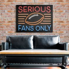 """Football Sign Art in Industrial Game Room. Cheer on the home team with retro inspired football art for the game room or man cave. Make your space your own with Mollie B's """"Neon Football Sign""""."""