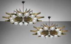 GIO PONTI Pair of chandeliers , circa 1965 Opaque glass, brass. Each: 38 in. (96.5 cm) drop, 67 1/4 in. (170.8 cm) diameter Manufactured by Arredoluce, Monza, Italy. Together with a certificate of authenticity from the Gio Ponti Archives.