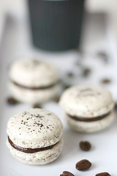... coffee and nutella macarons ... recipe here = http://call-me-cupcake.blogspot.gr/2010/01/coffee-and-nutella-macarons.html
