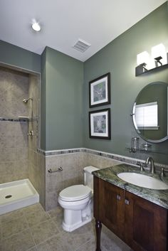 The Violet's 1st Floor Guest Bathroom. Again, lovely use of paint colors in this ceramic tiled bathroom. Finally, a Bathroom you're happy to let your guests use.