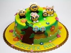 The Hive Cake - children birthday cake with sugar figurines - see more awesome cakes for kids in London - http://www.pinkcakeland.co.uk