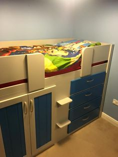 4 Drawer cabin bed in pavillion grey and royal blue. Aspenn Furniture make bespoke furniture  from solid natural woods to be the perfect addition to your home. From using the best quality solid natural pine or oak we can structurally guarantee our furniture to last, no mdf! We've never had anything break! Visit www.aspennfurniture.co.uk or contact us on 01937 843386 & ianaspenn@btinternet.com to discuss your ideas. Childrens Cabin Beds, Bespoke Furniture, Furniture Making, Natural Wood, Royal Blue, Woods, Pine, Drawers, Grey