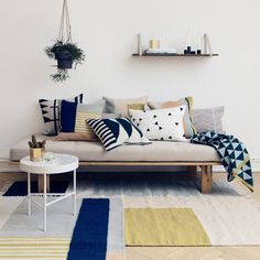 4 Ways To Use Navy Home Decor To Create A Modern Blue Living Room // Curtains, an area rug, throw pillows, and wall art are just a few of the ways you can add touches of navy to your space without the color feeling too dark or dominating.