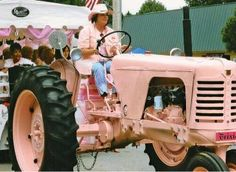 pretty pink tractor ... If I needed a tractor, this would be the one I'd get...