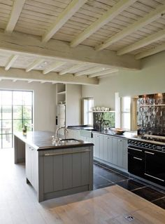 Grey and light wood tone kitchen/steel windows