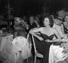 "Susan Hayward at the Cannes Film Festival in 1956 where she won Best Actress for ""I'll Cry Tomorrow"". Ginger Rogers is at table on the left, and Ingrid Bergman on right."