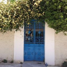 Poros Island, Poros, Greece — by Kelly S. Beautiful door. The initial letters of the owner can be noticed.