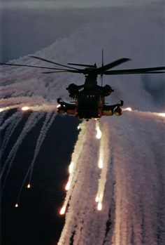 An MH-53J Pave Low IIIE from the 20th Special Operations Squadron, 16th Special Operations Wing, Hurlburt Field, Fla., expends flares over the Atlantic Ocean to demonstrate its defensive capabilities. Two Pave Lows were involved in the rescue of Vega 31. U.S. Air Force photo by Senior Master Sgt. Rose Reynolds