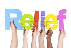 Diverse Hands Holding the Word Relief Stock Photo