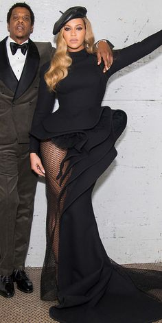 BEYONCÉ During the Clive Davis pre-Grammy party, Beyoncé proved that every fashion girl's favorite accessory, the beret, can also look cool with a fancy gown. For the red-carpet event, she chose a custom Azzi and Osta dress and Eugenia Kim hat.