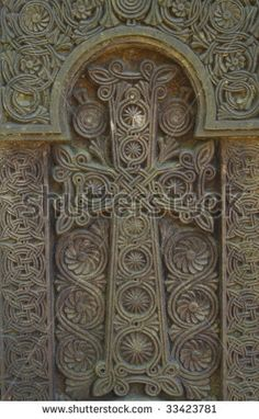 Close-up of Armenian cross carved in stone - stock photo