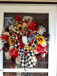 This Adorable Wreath is done with Cream Mesh and Red and Black accents. Theres a Proud Rooster in the center, with Black and White striped Burlap ribbon. Theres sunflowers and Ladybugs and finished with red and black deco tubing bows and last a Big Bow at the bottom.    Measures 28 by 28