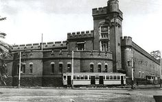 Fort Macquarie Tram Sheds, 1940 - Built after Fort Macquarie was demolished in 1901. the Fort Macquarie Tram Depot was a huge shed with brick walls, built like a gothic castle, with fabulous harbour views and tram tracks everywhere