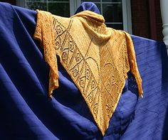 This triangular shawl was inspired by lace-like details on the Eiffel Tower. It is a charted and written lace design, with lace knitting on every other row.