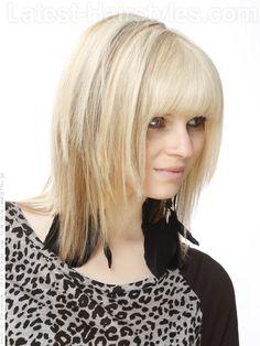 Classic Blonde Shag Cut with Long Bangs