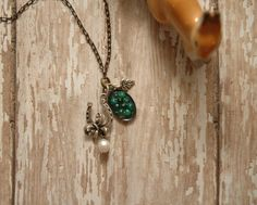 Lucky Horseshoe Gypsy Necklace Green Miniature Marbles Rhinestone Pearl Woodland Leaf Charm Silver Bow Ambient Atelier Art Jewelry Design by AmbientAtelier on Etsy