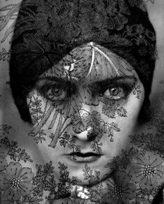 Gloria Swanson, 1924, Edward Steichen, taken for Vogue.  The detail is so good that you can see this is handmade Chantilly lace.  An original print of this photo sold for $540,000 at Phillips auction house, New York in 2007.