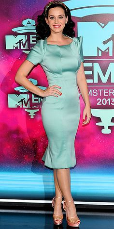 KATY PERRY Despite what Miley had us thinking, the invitation to the MTV EMAs in Amsterdam evidently did not read, over-the-top dress required. Katy plays it conservative in a pale-blue-green Zac Posen design, but brings her signature costume-y flair with a floral Dolce & Gabbana headband.