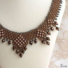 The drama of pattern, dramatic beaded cooper and peach pearl collar necklace with lustrous metallic crystals - Materials: seed beads, Swarovski crystals and Swarovski pearls - Color: metallic copper, pearl rose gold, gunmetal grey - Size 14 or 36 cm, custom length available - Style number 524