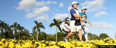 Hunter Maham walks with his caddie off the 15th tee of the Blue Monster during the third round of the 2011 WGC-Cadillac Championship at the Doral Golf Resort & Spa.