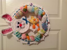 This wreath pattern had eggs crochet and put all around it and then had three eggs hanging in the middle.   I decided to make changes to it by crocheting a bunny head on top and then crocheting a duck and chicken to hang in the middle.