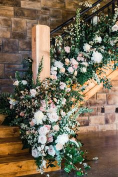 The newlyweds bypassed a traditional cocktail hour and ushered their guests directly into the reception, where they were met with food and drink. The two-floor reception was punctuated by one décor moment in particular—the pink, white, and green floral arrangement that covered the venue'sstaircase, which was also created by Zimmerman Events. Upstairs, guests could find cocktail tables that overlooked the dinner tables and outdoor dance floor below.