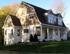 gambrel house exterior traditional with grass double front doors