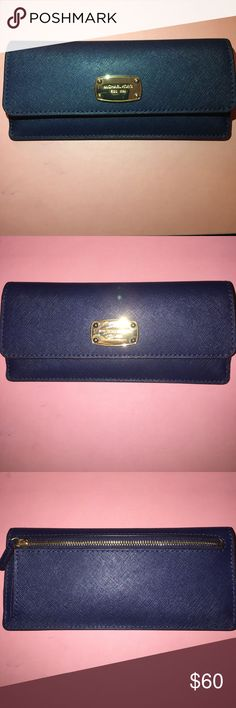 Michael Kors Navy Blue Wallet I've had this wallet for about 5 months. It has 12 card slots, six in the front when you open the flap and six on. The inside of the wallet. There is a small slot inside as well as the zipper small slot on the outside. Michael Kors Bags Wallets