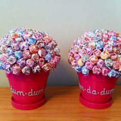 "Wedding shower centerpieces using Dum dums... Write ""Dum Dum da Dum"" on flower pots"