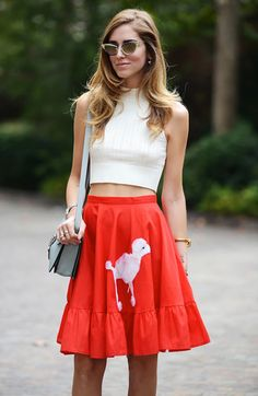 Opt for comfort in white cropped top and a red print skater skirt.  Shop this look for $93:  http://lookastic.com/women/looks/brown-sunglasses-and-white-cropped-top-and-light-blue-crossbody-bag-and-red-skater-skirt/4078  — Brown Sunglasses  — White Cropped Top  — Light Blue Leather Crossbody Bag  — Red Print Skater Skirt