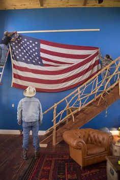 """Incorporate some """"rustic Americana"""" into your home this Fourth of July, like the Junk Gypsies did in their Wander Inn, with an American flag. See more photos of their patriotic style here: http://www.greatamericancountry.com/shows/junk-gypsies/decorating-the-junk-gypsy-wander-inn--pictures?soc=pinterest"""