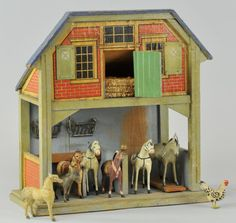 GOTTSCHALK HORSE STABLE  Germany, made of wood & painted in green overall, paper litho covering, opening barn door on loft level, ground floor contains two stalls & composition horses.