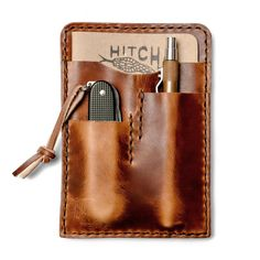 Story  A notebook caddy and wallet in one handmade from premium leather  Hitch & Timber strives to create unique and practical solutions for everyday carry that are fine-tuned through personal use. They use their products every day to make sure that when they reach you, they'll be every bit as useful, handy and handsome as they're meant to be. This all-in-one caddy for notebook, knife, pen and cash/cards makes it easy to fit everything you need for a day out in the field right i...