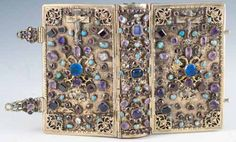 La Journée du Chrétien, Sanctifiée par la Prière et la Meditation. Lyon and Paris: Librairie Catholique de Perisse Frères, 1844. Small octavo. A seventeenth-century silver gilt, jewelled binding covering a French prayer book, which was placed into the binding at a later date.