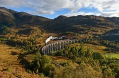 An LMS Stanier class 5 steam locomotive hauls The Jacobite train over the Glenfinnan Viaduct, made famous in the Harry Potter films, as the Western Highlands glow with the burning hues of autumn Photograph: Paul Kingston/North News & Pictures Ltd Hogwarts, World Conflicts, My Road Trip, Harry Potter Films, Steam Locomotive, Holiday Destinations, Kingston, The Guardian, New Pictures