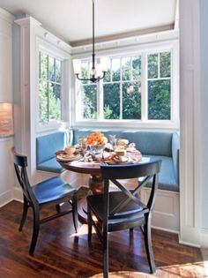 Round Table Design Feats Captivating Breakfast Nook With Bay Window Also Small Chandelier Plus Modern U Shaped Banquette