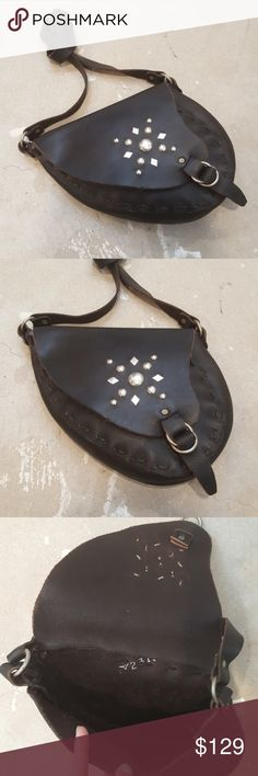 Genuine Black Leather Studded Saddle Crossbody Bag I am selling a stunning and unique, genuine black leather saddle bag.  This is so cool and sexy on.  A handmade, hand stitched piece which you are not likely to find again!  I adore this shape as a crossbody bag, it holds a ton and looks so flattering on.  The silver stud detail adds a simple design element which is eye catching yet subdued.  Ignite your boho, gypsy spirit and scoop this up.  Leather has a few scratches but nothing which…