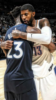 Jimmy Butler hugs Paul George