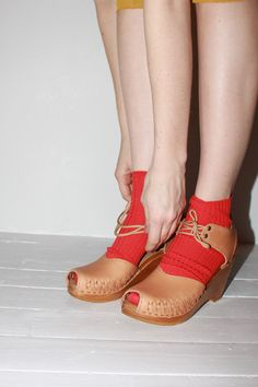 Modern wooden and leather clogs always remind me of medieval wooden pattens that are worn with shoes.