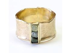 Ring hand-made to order in yellow gold pr 0585 (14K) kosteczkami of the rough diamond. Ring comes  the collection of jewelery inspired by ancient culture. There is an option for individuals looking for a bold and original jewelry. To emphasize the sculptural ornaments invoice creator and gently zmatowił zoksydował ring surface, leaving a polished center. Additional effect of the melt edges add a ring. It is performed on request by appointment size. Delivery time about 14 days. All their…