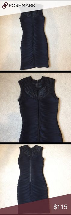 """BCBGMAXAZRIA Black ribbed cocktail dress Bring sexy back in this too hot to handle sold out fitted stretchy dress. The neckline has a subtle blue design and the front middle has silk shirred detail with an exposed back zipper. It feels like built in spanx and slims you while contouring all the right curves giving you an hourglass figure. Length hits above knee 34"""". Width armpit to armpit: 14"""". Keep in mind it stretches a ton! Condition NWOT. Don't miss this hot dress. BCBG Dresses"""