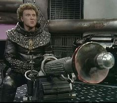 Colin Baker as Bayban the Butcher in 'Blake's (plastic grass and blood-stained apron not pictured). Best Sci Fi Series, Tv Series, Avant Garde Film, Colin Baker, Sci Fi Tv Shows, Sci Fi Fantasy, Fantasy Weapons, Bbc Tv, Retro Futuristic