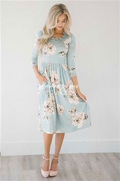 This adorable floral dress is Spring perfection! Cute pastel mint dress features a cream floral print, has an elastic waist, 3/4 length sleeves, and adorable side seam pockets!